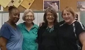 Lynnette Frazier (volunteer), Margaret Rhodes (volunteer), Georgia Mattison (staff), Fran Froehlich (staff)